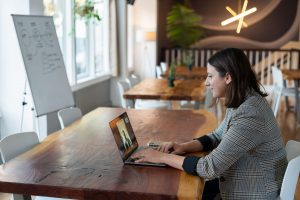 A woman working from a coworking space.